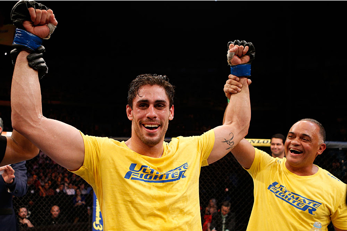 SAO PAULO, BRAZIL - MAY 31:  Antonio Carlos Junior celebrates after his unanimous decision victory over Vitor Miranda in their heavyweight fight during the UFC Fight Night event at the Ginasio do Ibirapuera on May 31, 2014 in Sao Paulo, Brazil. (Photo by