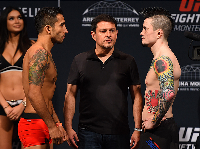 MONTERREY, MEXICO - NOVEMBER 20:  (L-R) Opponents Alejandro Perez of Mexico and Scott Jorgensen of the United States face off during the UFC weigh-in at the Arena Monterrey on November 20, 2015 in Monterrey, Mexico. (Photo by Jeff Bottari/Zuffa LLC/Zuffa