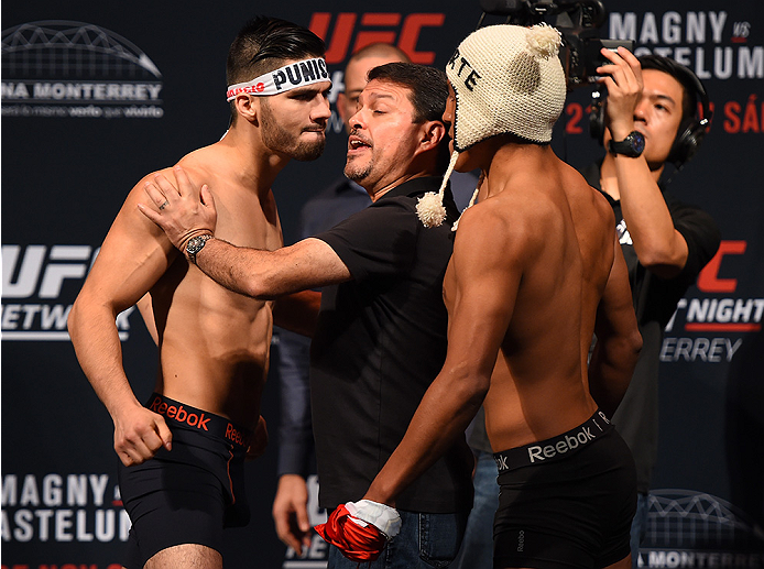 MONTERREY, MEXICO - NOVEMBER 20:  (L-R) Opponents  Horacio Gutierrez of Mexico and Enrique Barzola of Peru face off during the UFC weigh-in at the Arena Monterrey on November 20, 2015 in Monterrey, Mexico. (Photo by Jeff Bottari/Zuffa LLC/Zuffa LLC via Ge
