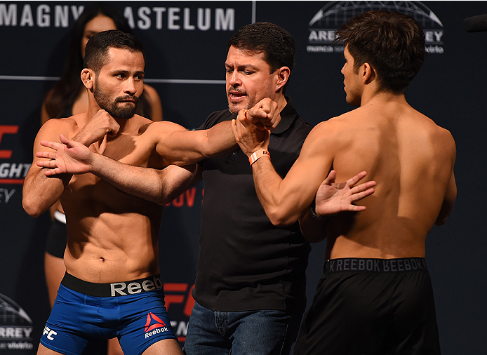 MONTERREY, MEXICO - NOVEMBER 20:  (L-R) Opponents Jussier Formiga of Brazil and Henry Cejudo of the United States face off during the UFC weigh-in at the Arena Monterrey on November 20, 2015 in Monterrey, Mexico. (Photo by Jeff Bottari/Zuffa LLC/Zuffa LLC