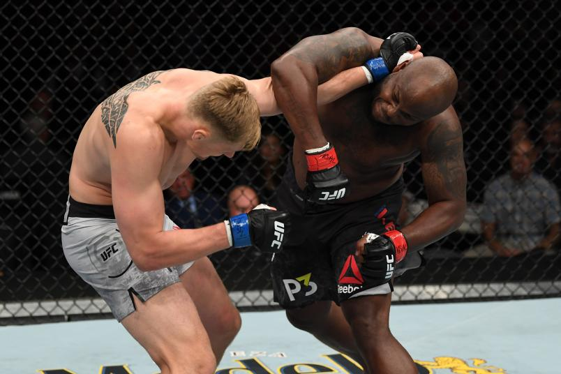 Derrick Lewis punches Alexander Volkov in their heavyweight bout during the UFC 229 event inside T-Mobile Arena on October 6, 2018 in Las Vegas, Nevada.