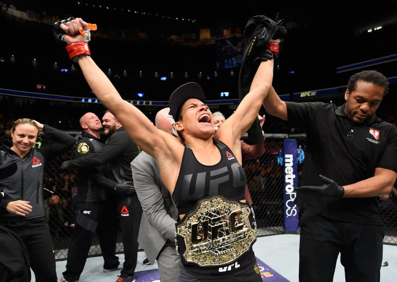 Amanda Nunes celebrates her win over Ronda Rousey in their UFC women's bantamweight championship bout during the UFC 207 event at T-Mobile Arena on December 30, 2016 in Las Vegas, Nevada.