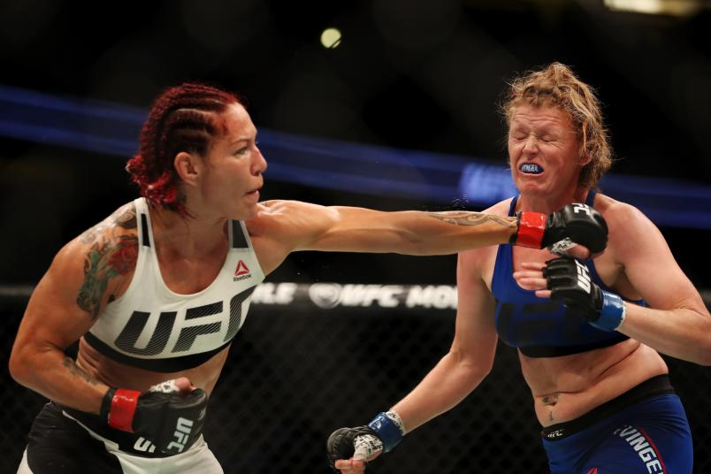 Cris Cyborg punches Tonya Evinger in their UFC women's featherweight championship bout during the UFC 214 event at Honda Center on July 29, 2017 in Anaheim, California.