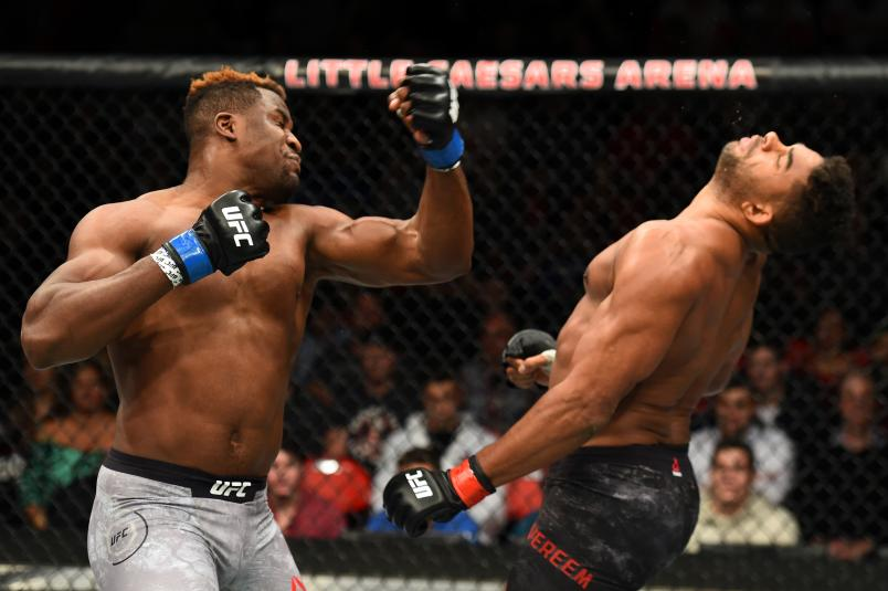 DETROIT, MI - DECEMBER 02:  (L-R) Francis Ngannou of Cameroon punches Alistair Overeem of The Netherlands in their heavyweight bout during the UFC 218 event inside Little Caesars Arena on December 02, 2017 in Detroit, Michigan. (Photo by Josh Hedges/Zuffa LLC via Getty Images)