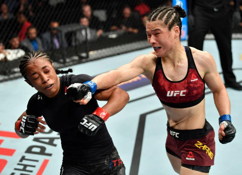 LOS ANGELES, CA - AUGUST 04: (R-L) Weili Zhang of China punches Danielle Taylor in their women's strawweight fight during the UFC 227 event inside Staples Center on August 4, 2018 in Los Angeles, California. (Photo by Jeff Bottari/Zuffa LLC/Zuffa LLC via Getty Images)
