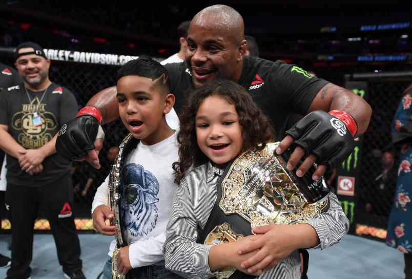 NEW YORK, NY - NOVEMBER 03:  Daniel Cormier celebrates with his kids after his submission victory over Derrick Lewis in their UFC heavyweight championship bout during the UFC 230 event inside Madison Square Garden on November 3, 2018 in New York, New York. (Photo by Jeff Bottari/Zuffa LLC)