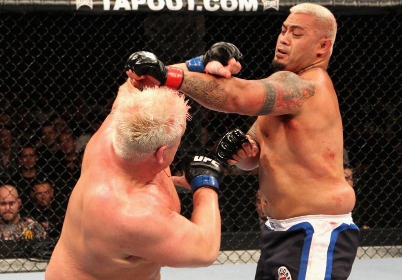 SYDNEY, AUSTRALIA - FEBRUARY 27: Mark Hunt (R) of New Zealand punches Chris Tuchscherer (L) of the USA during their Heavyweight bout at UFC 127 at Acer Arena on February 27, 2011 in Sydney, Australia. (Photo by Josh Hedges/Zuffa LLC/Getty Images)