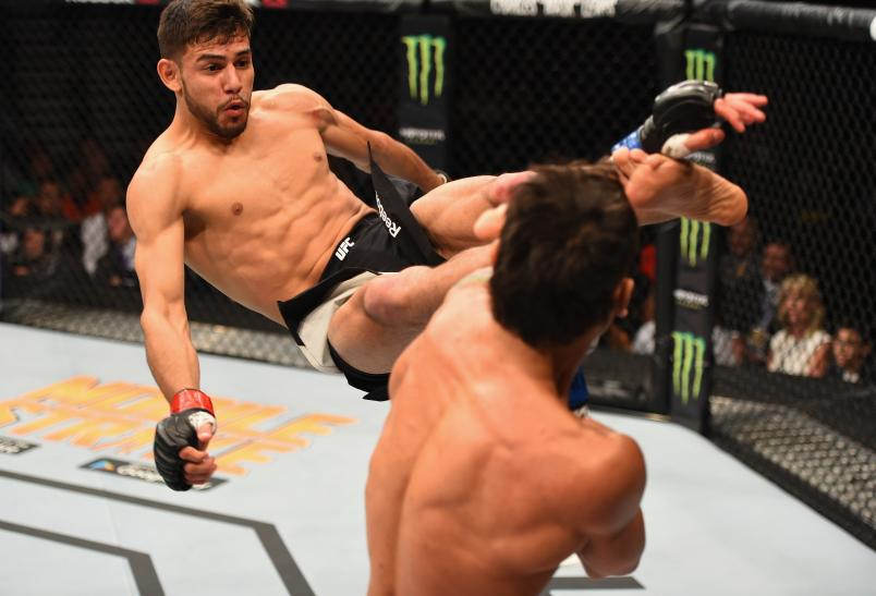 LAS VEGAS, NV - APRIL 23: (L-R) Yair Rodriguez of Mexico kicks Andre Fili in their featherweight bout during the UFC 197 event inside MGM Grand Garden Arena on April 23, 2016 in Las Vegas, Nevada. (Photo by Josh Hedges/Zuffa LLC/Zuffa LLC via Getty Images)
