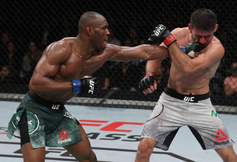Kamaru Usman of Nigeria punches Demian Maia of Brazil in their welterweight bout during the UFC Fight Night event at Movistar Arena on May 19, 2018 in Santiago, Chile. (Photo by Buda Mendes/Zuffa LLC/Zuffa LLC via Getty Images)