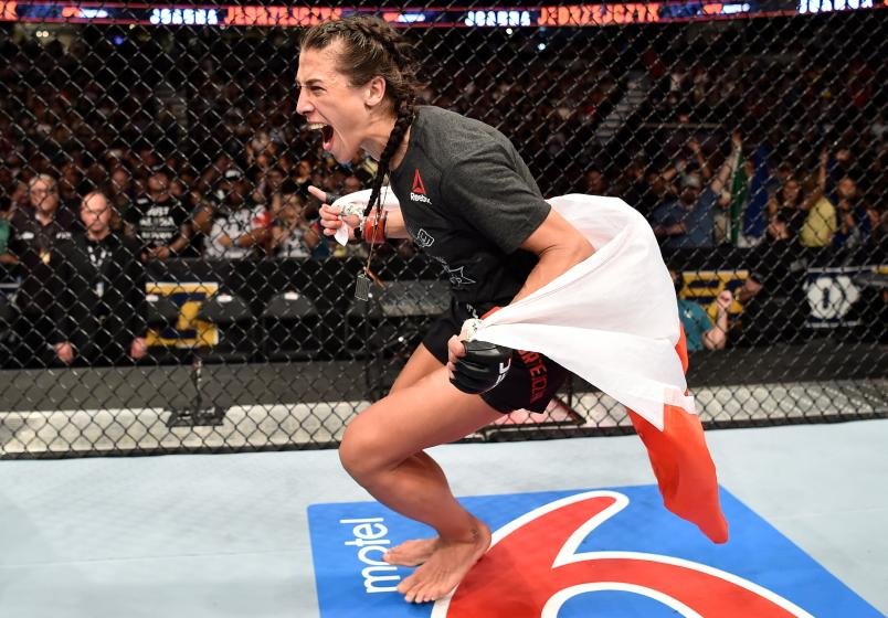 CALGARY, AB - JULY 28: Joanna Jedrzejczyk of Poland celebrates after he decision victory over Tecia Torres in their women's strawweight bout during the UFC Fight Night event at Scotiabank Saddledome on July 28, 2018 in Calgary, Alberta, Canada. (Photo by Jeff Bottari/Zuffa LLC/Zuffa LLC via Getty Images)