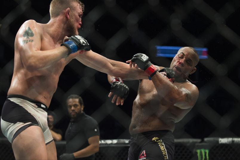 HOUSTON, TX - OCTOBER 03: (R-L) Alexander Gustafsson punches Daniel Cormier in their UFC light heavyweight championship bout during the UFC 192 event at the Toyota Center on October 3, 2015 in Houston, Texas. (Photo by Jeff Bottari/Zuffa LLC/Zuffa LLC via Getty Images)