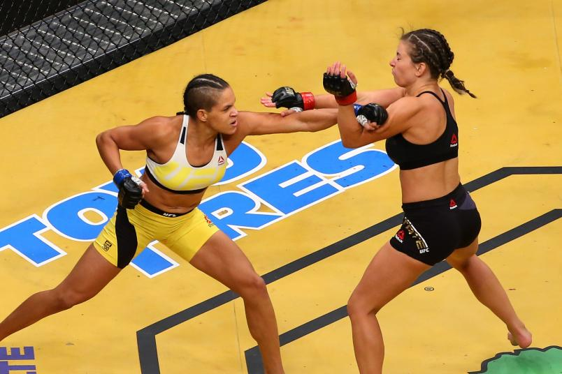 LAS VEGAS, NV - JULY 09: (L-R) Amanda Nunes of Brazil punches Miesha Tate during the UFC 200 event on July 9, 2016 at T-Mobile Arena in Las Vegas, Nevada. (Photo by Ed Mulholland/Zuffa LLC/Zuffa LLC via Getty Images)