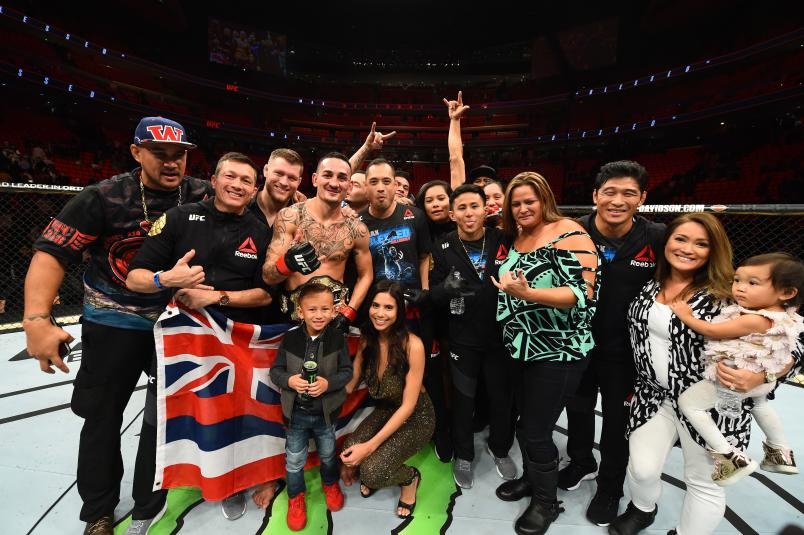 DETROIT, MI - DECEMBER 02: UFC featherweight champion Max Holloway celebrates with his family, teammates and coaches after defeating Jose Aldo of Brazil in their UFC featherweight championship bout during the UFC 218 event inside Little Caesars Arena on December 02, 2017 in Detroit, Michigan. (Photo by Josh Hedges/Zuffa LLC/Zuffa LLC via Getty Images)