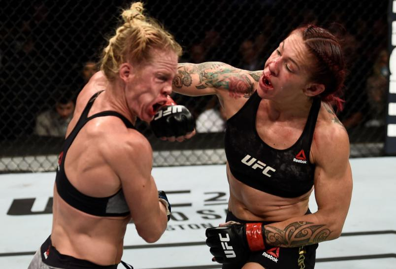 LAS VEGAS, NV - DECEMBER 30: (R-L) Cris Cyborg of Brazil punches Holly Holm in their women's featherweight bout during the UFC 219 event inside T-Mobile Arena on December 30, 2017 in Las Vegas, Nevada. (Photo by Jeff Bottari/Zuffa LLC/Zuffa LLC via Getty Images)