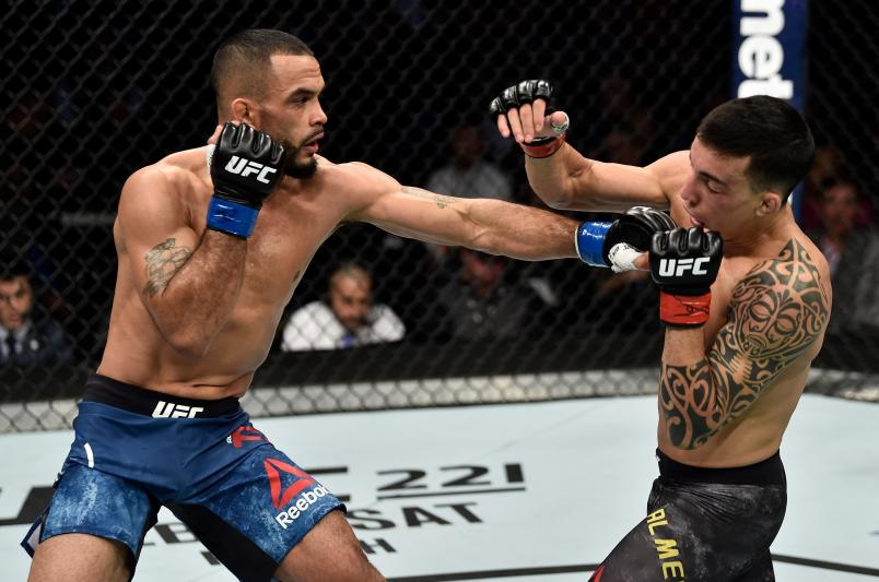 BOSTON, MA - JANUARY 20:  (L-R) Rob Font punches Thomas Almeida of Brazil in their bantamweight bout during the UFC 220 event at TD Garden on January 20, 2018 in Boston, Massachusetts. (Photo by Jeff Bottari/Zuffa LLC/Zuffa LLC via Getty Images)