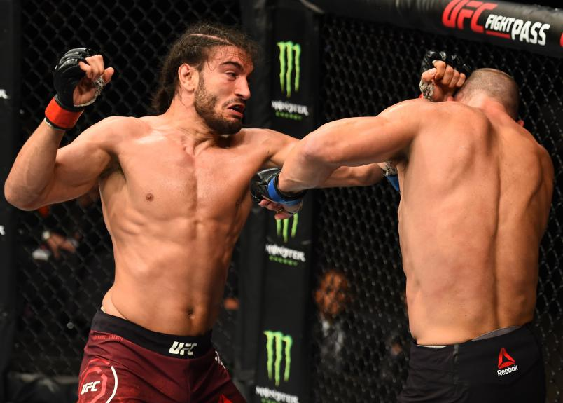 LIVERPOOL, ENGLAND - MAY 27: (L-R) Elias Theodorou of Canada punches Trevor Smith in their middleweight bout during the UFC Fight Night event at ECHO Arena on May 27, 2018 in Liverpool, England. (Photo by Josh Hedges/Zuffa LLC/Zuffa LLC via Getty Images)