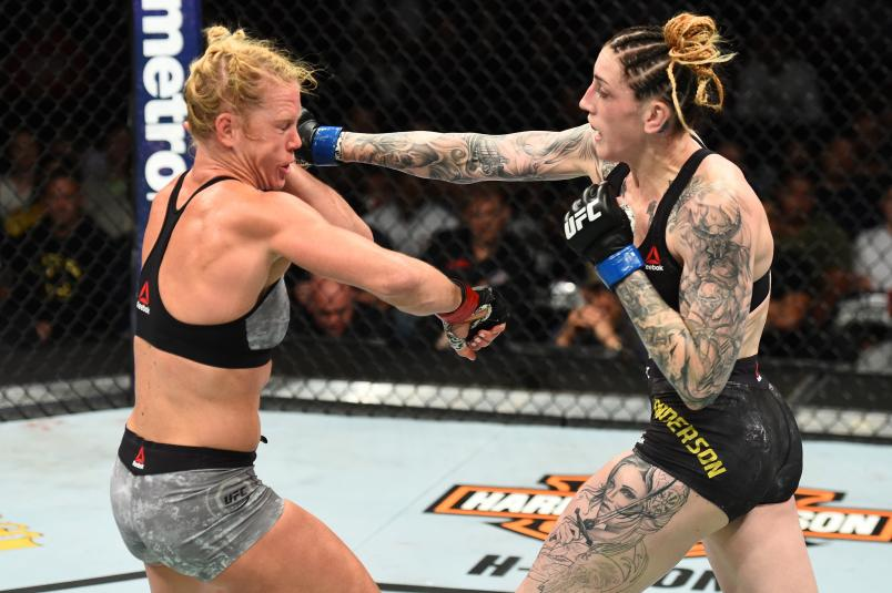 CHICAGO, ILLINOIS - JUNE 09: (R-L) Megan Anderson of Australia punches Holly Holm in their women's featherweight fight during the UFC 225 event at the United Center on June 9, 2018 in Chicago, Illinois. (Photo by Josh Hedges/Zuffa LLC/Zuffa LLC via Getty Images)