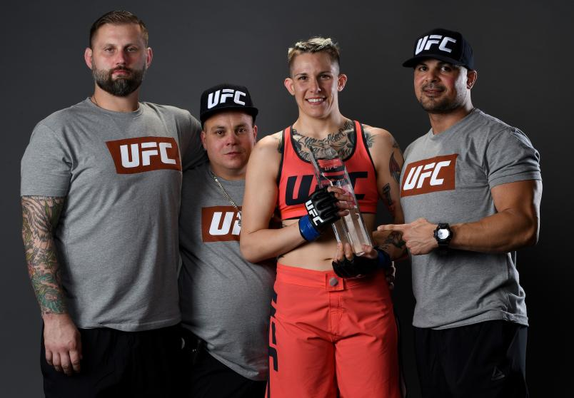 LAS VEGAS, NV - NOVEMBER 30: Macy Chiasson poses for a portrait backstage with her team after her victory over Pannie Kianzad during The Ultimate Fighter Finale event inside The Pearl concert theater at Palms Casino Resort on November 30, 2018 in Las Vegas, Nevada. (Photo by Mike Roach/Zuffa LLC/Zuffa LLC via Getty Images)