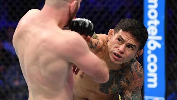 TORONTO, CANADA - DECEMBER 08: (R-L) Diego Ferreira of Brazil punches Kyle Nelson of Canada in their lightweight fight during the UFC 231 event at Scotiabank Arena on December 8, 2018 in Toronto, Canada. (Photo by Josh Hedges/Zuffa LLC/Zuffa LLC via Getty Images)