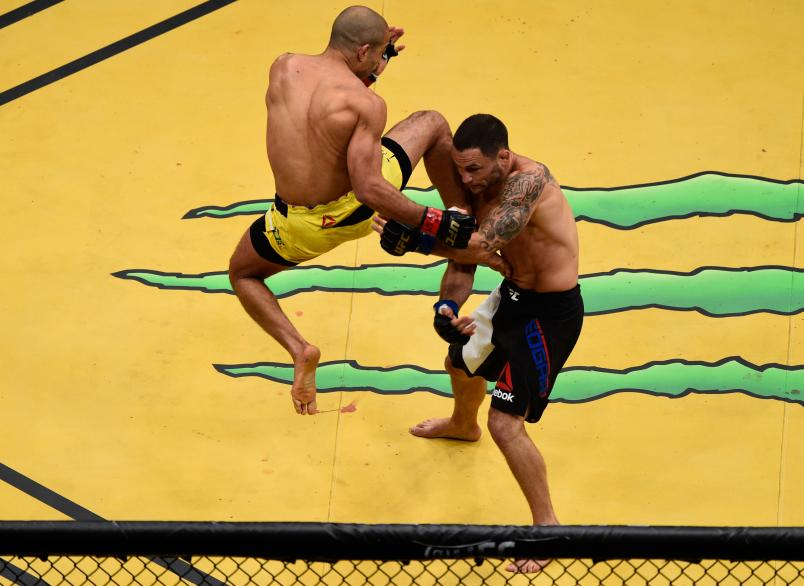 LAS VEGAS, NV - JULY 09: (L-R) Jose Aldo of Brazil punches Frankie Edgar during the UFC 200 event on July 9, 2016 at T-Mobile Arena in Las Vegas, Nevada. (Photo by Jeff Bottari/Zuffa LLC/Zuffa LLC via Getty Images)