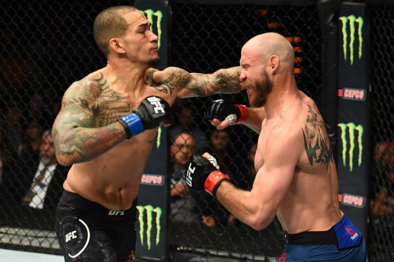 AUSTIN, TX - FEBRUARY 18: Yancy Medeiros (L) punches Donald Cerrone in their welterweight bout during the UFC Fight Night event at Frank Erwin Center on February 18, 2018 in Austin, Texas. (Photo by Josh Hedges/Zuffa LLC/Zuffa LLC via Getty Images)