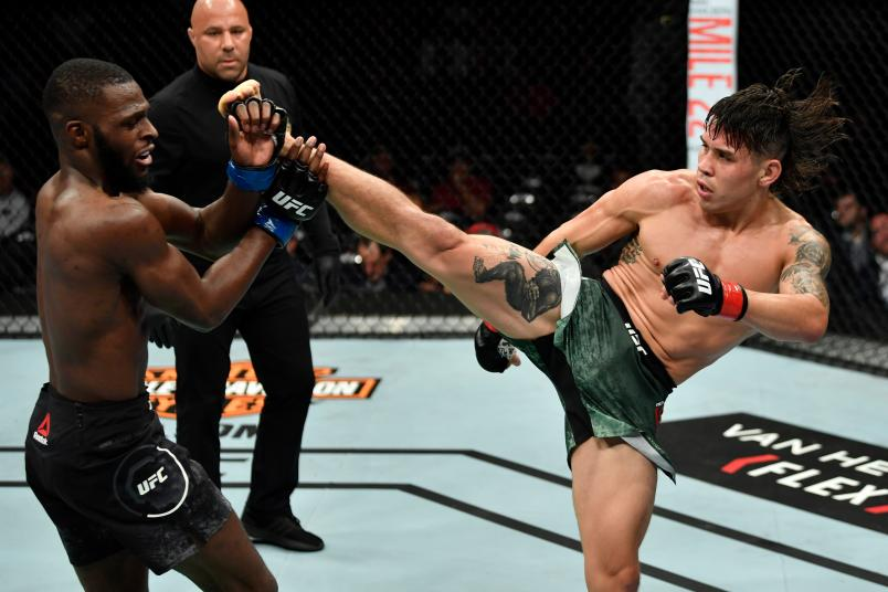 LOS ANGELES, CA - AUGUST 04: (R-L) Ricky Simon kicks Montel Jackson in their bantamweight fight during the UFC 227 event inside Staples Center on August 4, 2018 in Los Angeles, California. (Photo by Jeff Bottari/Zuffa LLC/Zuffa LLC via Getty Images)