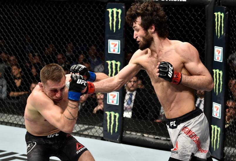 BROOKLYN, NEW YORK - APRIL 07: (R-L) Zabit Magomedsharipov of Russia punches Kyle Bochniak in their featherweight bout during the UFC 223 event inside Barclays Center on April 7, 2018 in Brooklyn, New York. (Photo by Jeff Bottari/Zuffa LLC/Zuffa LLC via Getty Images)