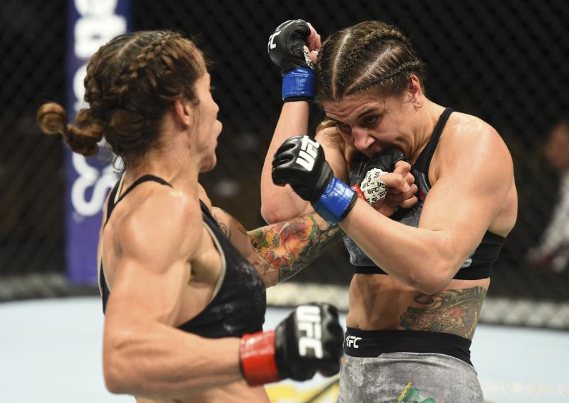 BOISE, ID - JULY 14: (L-R) Liz Carmouche punches Jennifer Maia of Brazil in their women's flyweight fight during the UFC Fight Night event inside CenturyLink Arena on July 14, 2018 in Boise, Idaho. (Photo by Josh Hedges/Zuffa LLC/Zuffa LLC via Getty Images)