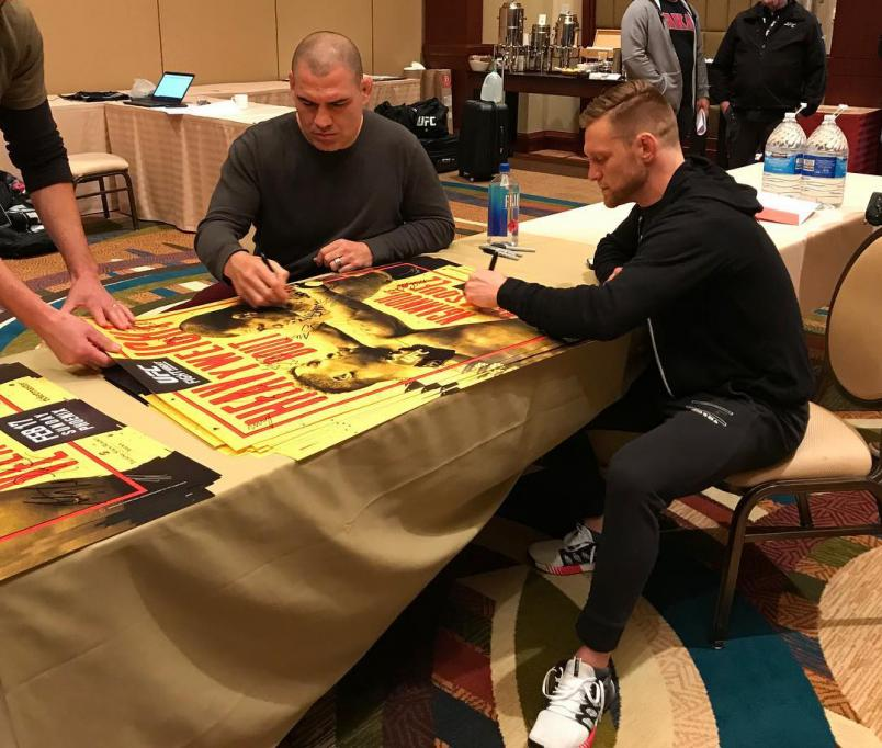 Cain Velasquez and Scott Holtzman Sign Posters For UFC Phoenix