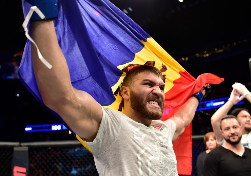CALGARY, AB - JULY 28: Ion Cutelaba of the Republic of Moldova celebrates after his victory over Gadzhimurad Antigulov in their light heavyweight bout during the UFC Fight Night event at Scotiabank Saddledome on July 28, 2018 in Calgary, Alberta, Canada. (Photo by Jeff Bottari/Zuffa LLC/Zuffa LLC via Getty Images)