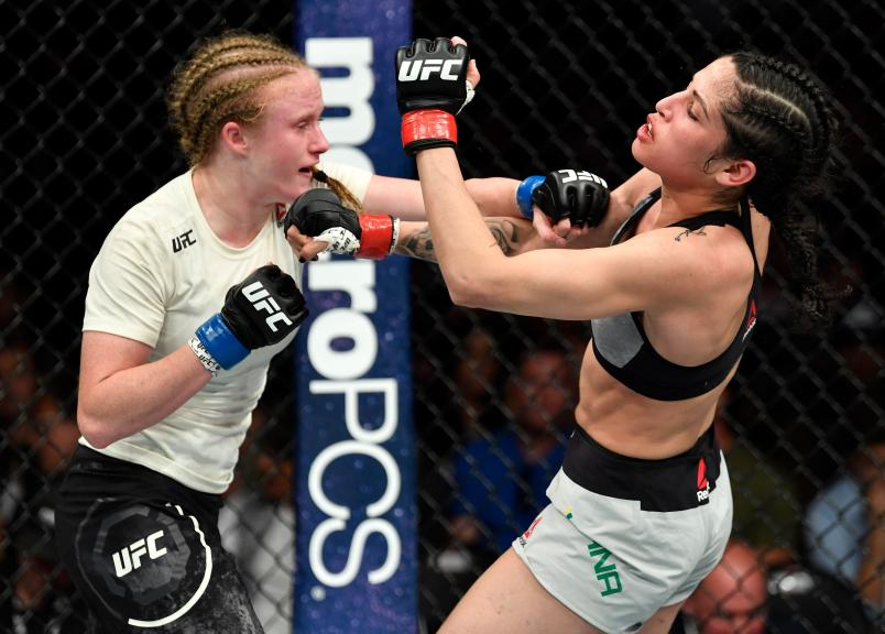 LOS ANGELES, CA - AUGUST 04: (L-R) JJ Aldrich punches Polyana Viana of Brazil in their women's strawweight fight during the UFC 227 event inside Staples Center on August 4, 2018 in Los Angeles, California. (Photo by Jeff Bottari/Zuffa LLC/Zuffa LLC via Getty Images)