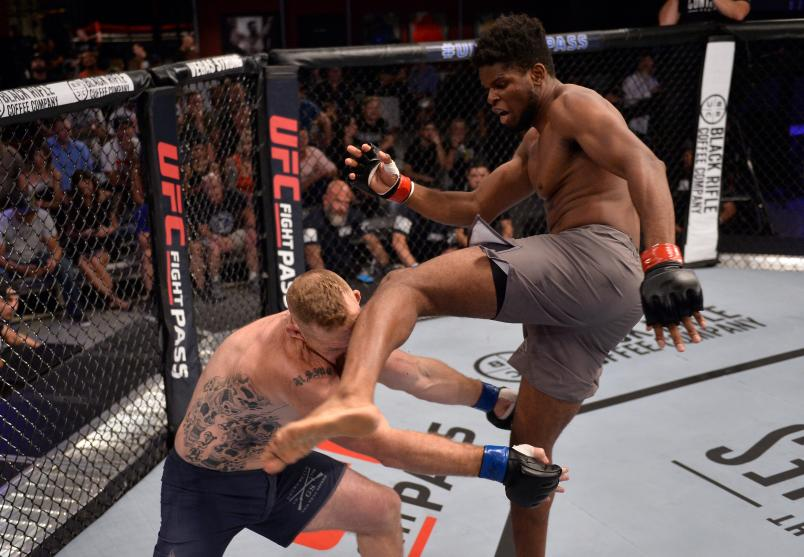 LAS VEGAS, NV - AUGUST 07: (R-L) Kennedy Nzechukwu kicks Dennis Bryant in their light heavyweight fight during Dana White's Tuesday Night Contender Series at the TUF Gym on August 7, 2018 in Las Vegas, Nevada. (Photo by Chris Unger/DWTNCS LLC)