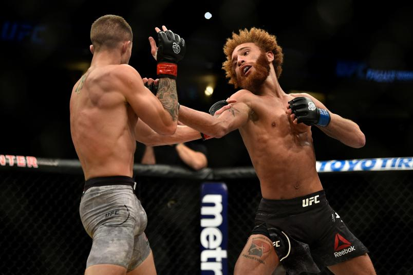 DENVER, CO - NOVEMBER 10: (R-L) Luis Pena punches Michael Trizano in their lightweight bout during the UFC Fight Night event inside Pepsi Center on November 10, 2018 in Denver, Colorado. (Photo by Chris Unger/Zuffa LLC/Zuffa LLC via Getty Images)
