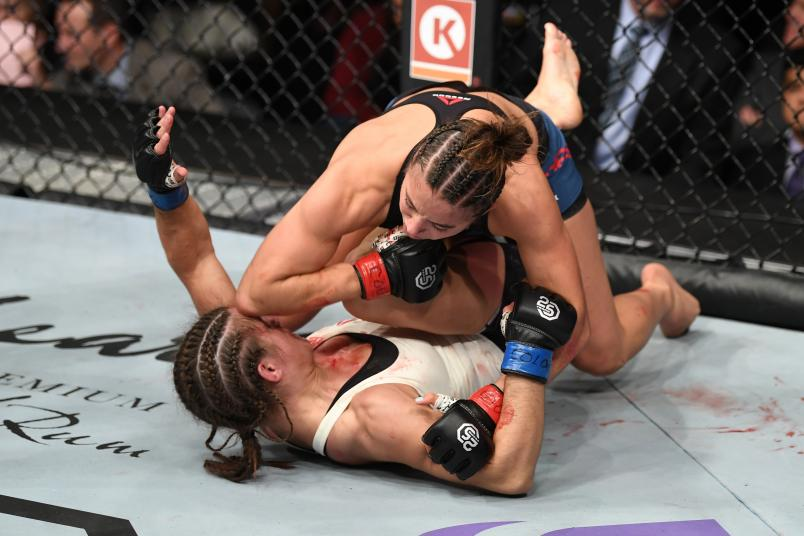 DENVER, CO - NOVEMBER 10: (R-L) Maycee Barber land an elbow to the head of Hannah Cifers in their women's strawweight bout during the UFC Fight Night event inside Pepsi Center on November 10, 2018 in Denver, Colorado. (Photo by Josh Hedges/Zuffa LLC/Zuffa LLC via Getty Images)