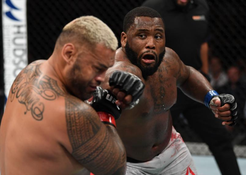 ADELAIDE, AUSTRALIA - DECEMBER 02: (R-L) Justin Willis punches Mark Hunt of New Zealand in their heavyweight bout during the UFC Fight Night event inside Adelaide Entertainment Centre on December 2, 2018 in Adelaide, Australia. (Photo by Jeff Bottari/Zuffa LLC/Zuffa LLC via Getty Images)