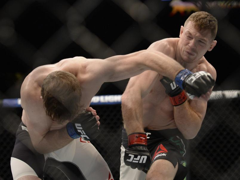 LAS VEGAS, NV - JULY 07: (R-L) Joe Duffy of Ireland punches Mitch Clarke of Canada in their lightweight bout during the UFC Fight Night event inside the MGM Grand Garden Arena on July 7, 2016 in Las Vegas, Nevada. (Photo by Brandon Magnus/Zuffa LLC/Zuffa LLC via Getty Images)