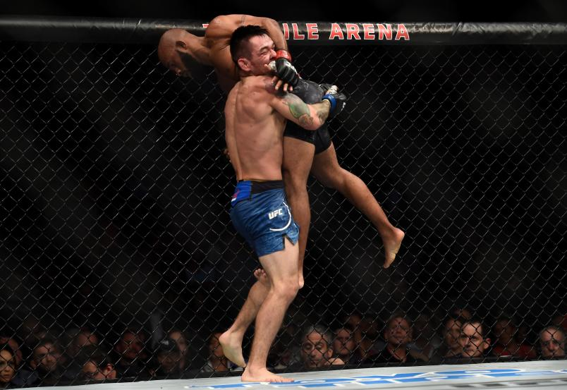 LAS VEGAS, NV - OCTOBER 07: (L-R) Ray Borg takes down Demetrious Johnson in their UFC flyweight championship bout during the UFC 216 event inside T-Mobile Arena on October 7, 2017 in Las Vegas, Nevada. (Photo by Brandon Magnus/Zuffa LLC/Zuffa LLC via Getty Images)