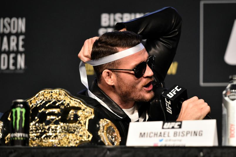 NEW YORK, NY - NOVEMBER 02: UFC Middleweight Champion Michael Bisping of England interacts with his opponent Georges St-Pierre of Canada (not pictured) during the UFC 217 Press Conference inside Madison Square Garden on November 2, 2017 in New York City. (Photo by Jeff Bottari/Zuffa LLC/Zuffa LLC via Getty Images)
