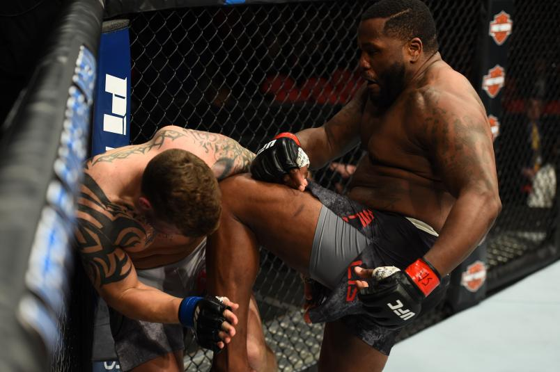 DETROIT, MI - DECEMBER 02: (R-L) Justin Willis lands a knee to the body of Allen Crowder in their heavyweight bout during the UFC 218 event inside Little Caesars Arena on December 02, 2017 in Detroit, Michigan. (Photo by Josh Hedges/Zuffa LLC/Zuffa LLC via Getty Images)