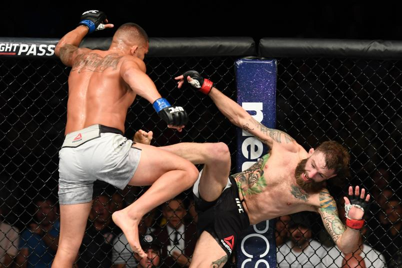LAS VEGAS, NV - JULY 07: Anthony Pettis kicks Michael Chiesa in their lightweight fight during the UFC 226 event inside T-Mobile Arena on July 7, 2018 in Las Vegas, Nevada. (Photo by Josh Hedges/Zuffa LLC/Zuffa LLC via Getty Images)