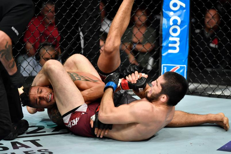 CALGARY, AB - JULY 28: (R-L) Islam Makhachev of Russia secures an arm bar submission against Kajan Johnson of Canada in their lightweight bout during the UFC Fight Night event at Scotiabank Saddledome on July 28, 2018 in Calgary, Alberta, Canada. (Photo by Jeff Bottari/Zuffa LLC/Zuffa LLC via Getty Images)