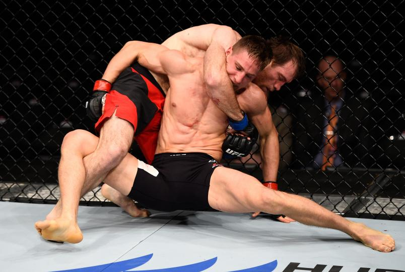 SACRAMENTO, CA - DECEMBER 17: (L-R) Sultan Aliev of Russia controls the body of Bojan Velickovic of Serbia in their welterweight bout during the UFC Fight Night event inside the Golden 1 Center Arena on December 17, 2016 in Sacramento, California. (Photo by Jeff Bottari/Zuffa LLC/Zuffa LLC via Getty Images)