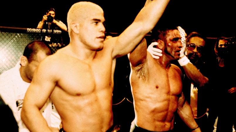 LAS VEGAS, NV - NOVEMBER 22:  Ken Shamrock (R) raises Tito Ortiz's hand in victory after Ortiz defeated Shamrock by unanimous decision at UFC 40 at the MGM Grand Garden Arena on November 22, 2002 in Las Vegas, Nevada.  (Photo by Josh Hedges/Zuffa LLC/Zuff