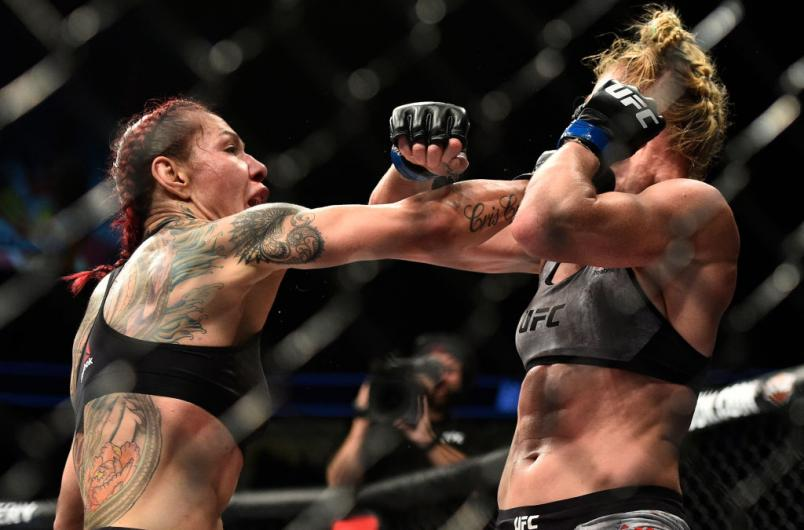 LAS VEGAS, NV - DECEMBER 30:  (L-R) Cris Cyborg of Brazil punches Holly Holm in their women's featherweight bout during the UFC 219 event inside T-Mobile Arena on December 30, 2017 in Las Vegas, Nevada. (Photo by Brandon Magnus/Zuffa LLC/Zuffa LLC via Get