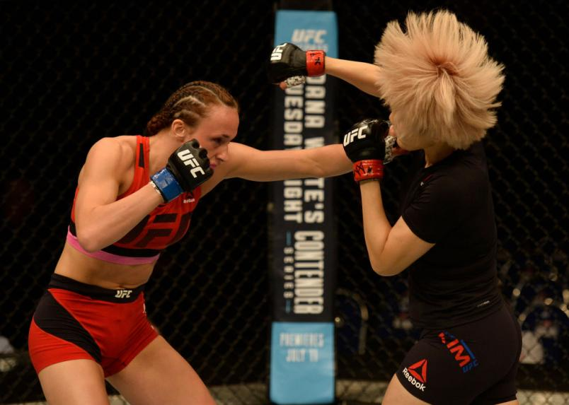 SINGAPORE - JUNE 17:   (L-R) Lucie Pudilova punches Ji Yeon Kim of South Korea in their women's bantamweight bout during the UFC Fight Night event at the Singapore Indoor Stadium on June 17, 2017 in Singapore. (Photo by Brandon Magnus/Zuffa LLC)