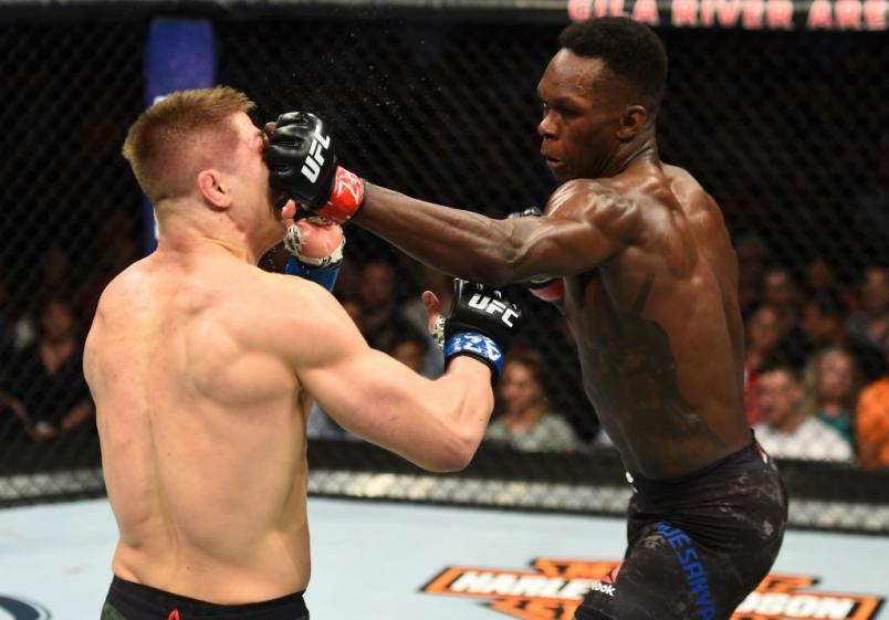 GLENDALE, AZ - APRIL 14:  (R-L) Israel Adesanya of Nigeria punches Marvin Vettori of Italy in their middleweight fight during the UFC Fight Night event at the Gila Rivera Arena on April 14, 2018 in Glendale, Arizona. (Photo by Josh Hedges/Zuffa LLC/Zuffa
