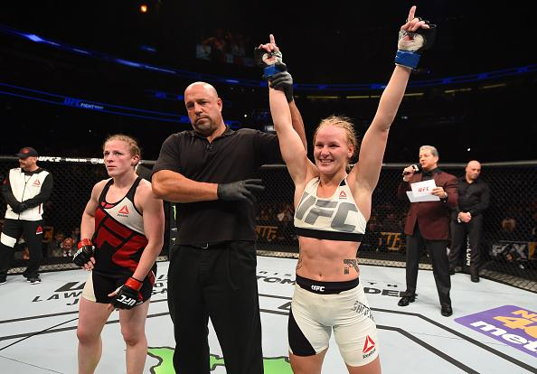 ORLANDO, FL - DECEMBER 19:   (R-L) Valentina Shevchenko celebrates her victory over Sarah Kaufman in their women's bantamweight bout during the UFC Fight Night event at the Amway Center on December 19, 2015 in Orlando, Florida. (Photo by Josh Hedges/Zuffa