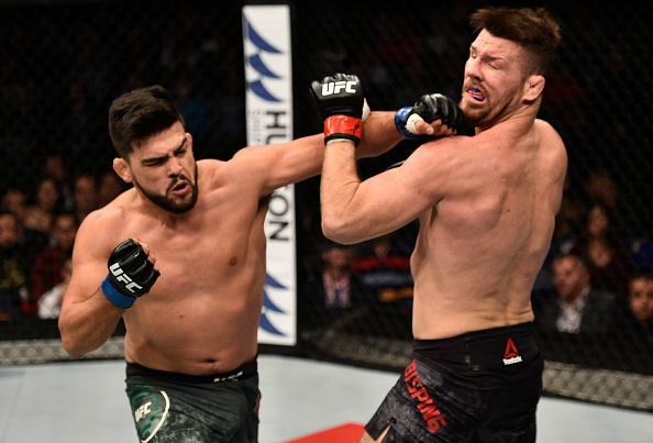 SHANGHAI, CHINA - NOVEMBER 25:  Kelvin Gastelum punches Michael Bisping of England in their middleweight bout during the UFC Fight Night event inside the Mercedes-Benz Arena on November 25, 2017 in Shanghai, China. (Photo by Brandon Magnus/Zuffa LLC via G