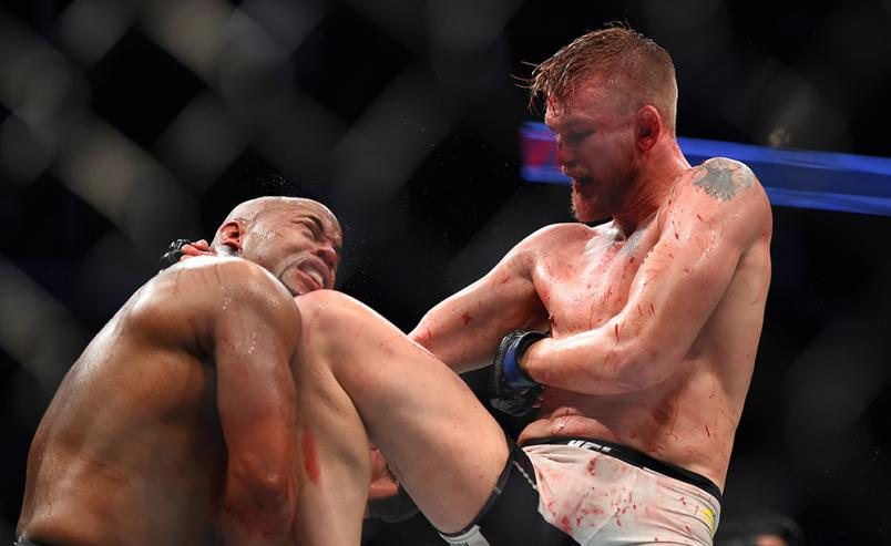 HOUSTON, TX - OCTOBER 03:  (R-L) Alexander Gustafsson lands a knee to the chin of Daniel Cormier in their UFC light heavyweight championship bout during the UFC 192 event at the Toyota Center on October 3, 2015 in Houston, Texas. (Photo by Jeff Bottari/Zu