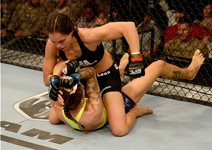 FORT CAMPBELL, KENTUCKY - NOVEMBER 6:  Amanda Nunes (top) punches Germaine de Randamie in their UFC women's bantamweight bout on November 6, 2013 in Fort Campbell, Kentucky. (Photo by Jeff Bottari/Zuffa LLC/Zuffa LLC via Getty Images) *** Local Caption **